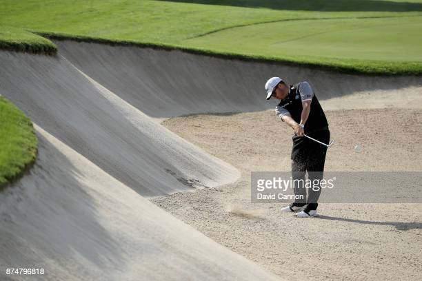 George Coetzee of South Africa plays his second shot on the third hole during the first round of the DP World Tour Championship on the Earth Course...
