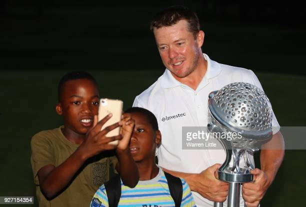 George Coetzee of South Africa poses for a fans picture after winning the Tshwane Open at Pretoria Country Club on March 4 2018 in Pretoria South...