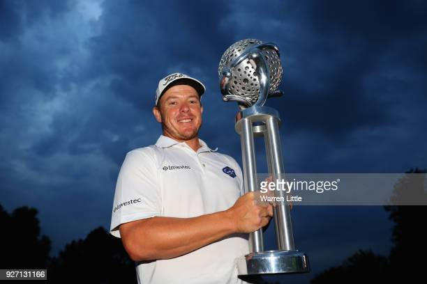 George Coetzee of South Africa poses with the trophy after winning the Tshwane Open at Pretoria Country Club on March 4 2018 in Pretoria South Africa