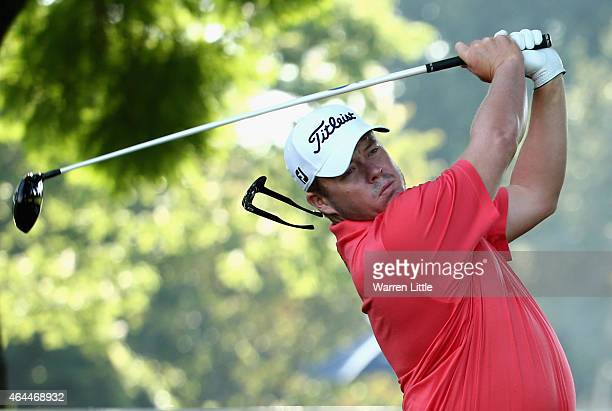 George Coetzee of South Africa tees off on the first hole as his sunglasses slip off his hat during the first round of the Joburg Open at Royal...