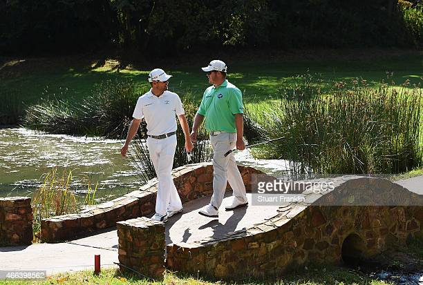 George Coetzee of South Africa walks over a bridge with playing partner Trevor Fisher Jnr of South Africa during the final round of the Tshwane Open...