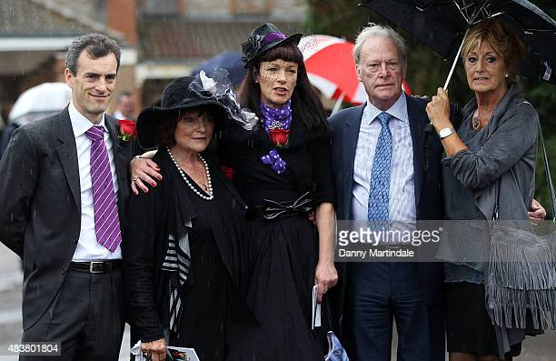 George Cole's Son his wife Penny Morrell and daughter Tara Cole stand with Actor Dennis Waterman and Dennis Waterman's wife Pam Flint as they attend...
