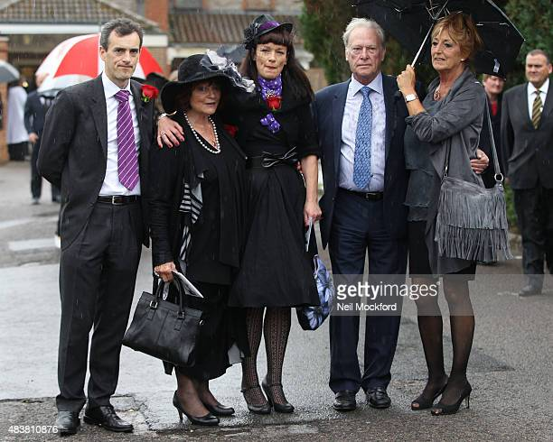 George Cole's son Toby his wife Penny Morrell and daughter Tara Cole with Dennis Waterman and his wife Pam Flint attend the funeral of George Cole at...
