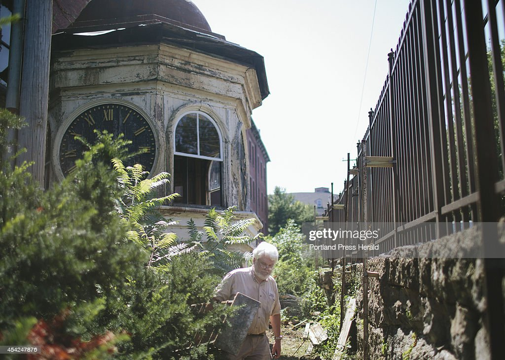 George Collord walks through the Pepperell Mill Campus where the Lincoln Mill clock tower is currently housed in Biddeford, ME on Tuesday, August 26, 2014. 'Seeing this clock tower eventually move, it's a symbolic resurgence of everything that's best about this place.'