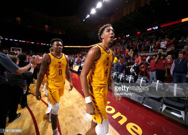 George Conditt IV and Zion Griffin of the Iowa State Cyclones celebrate after defeating the Seton Hall Pirates 76-66 at Hilton Coliseum on December...