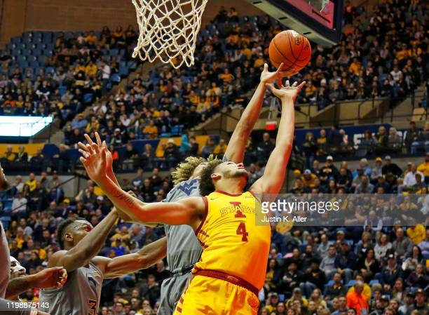George Conditt IV of the Iowa State Cyclones battles for a rebound against the West Virginia Mountaineers at the WVU Coliseum on February 5 2020 in...