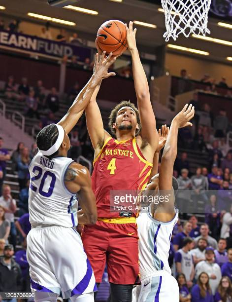 George Conditt IV of the Iowa State Cyclones drives to the basket against Xavier Sneed of the Kansas State Wildcats during the first half at Bramlage...