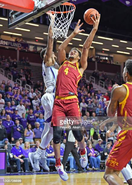 George Conditt IV of the Iowa State Cyclones drives to the basket against Levi Stockard III of the Kansas State Wildcats during the first half at...