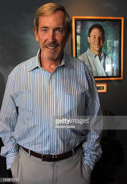 George Conrades Executive Chairman of Akamai Technologies in the company lobby with a portrait of Danny Lewin cofounder of the company who was killed...