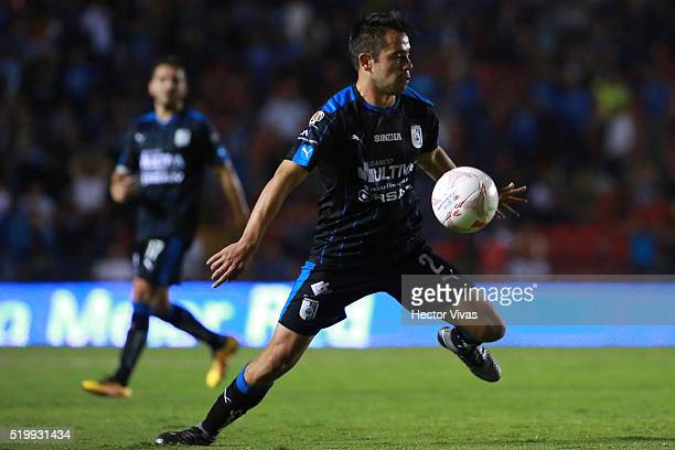George Corral of Queretaro drives the ball during the 13th round match between Queretaro and Toluca as part of the Clausura 2016 Liga MX at La...