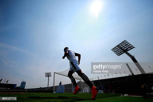 George Corral of Queretaro enters to the field prior to the 17th round match between Pumas UNAM and Queretaro as part of the Torneo Clausura 2018...