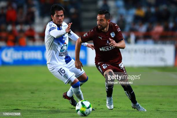 George Corral of Queretaro struggles for the ball against Jorge Hernández of Queretaro during the 2nd round match between Pachuca and Queretaro as...
