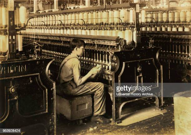 George Courtemonds 14 years old Oiler Boy Oils all Spindles in Spinning Room King Philip Mills Fall River Massachusetts USA Lewis Hine for National...