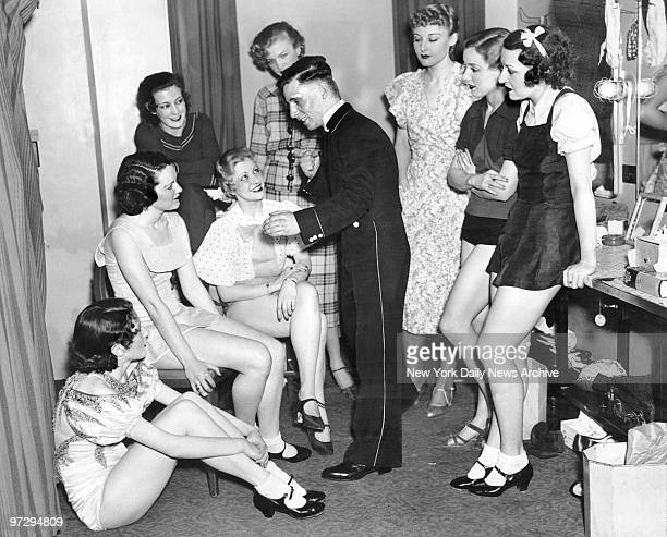 George Coyle Daily News Golden Gloves winner 112 lb open champ who works as an usher at the Radio City Music Hall is shown keeping some of the...