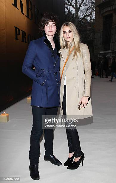George Craig and Cara Delevingne attend the Burberry Prorsum Fashion Show as part of Milan Fashion Week Menswear A/W 2011 on January 15 2011 in Milan...