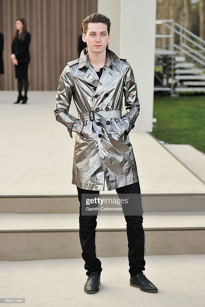 George Craig wearing Burberry arrives at the Burberry Prorsum Autumn Winter 2013 Womenswear Show on February 18, 2013 in London, England.
