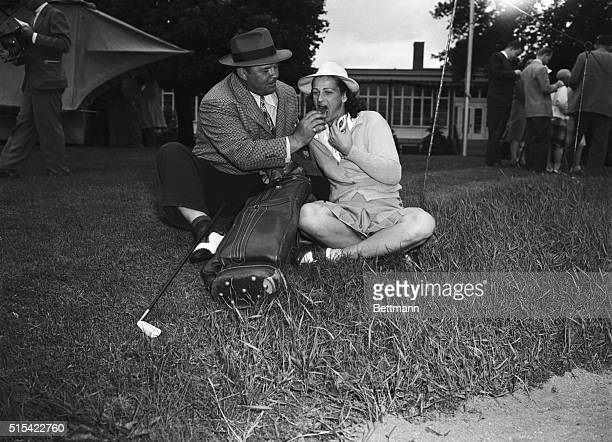 George Cry Baby Zaharias the reformed wrestler and his wife the former Babe Didrikson of Beverly Hills California share hot dogs while waiting for...