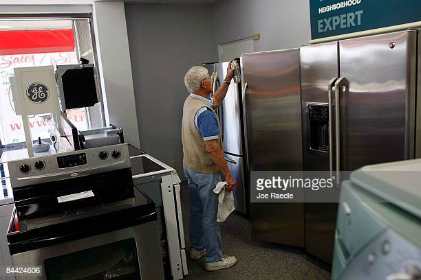 George Daniel Fortney dusts off General Electric appliances at Fortney's Appliance store on January 23 2009 in Fort Lauderdale Florida General...