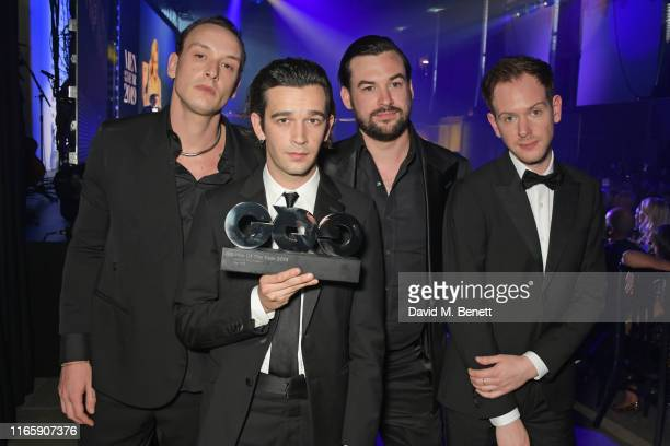George Daniel Matthew Healy Ross MacDonald and Adam Hann of The 1975 winners of the GQ Band of the Year award attend the the GQ Men Of The Year...
