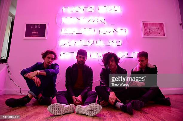 """George Daniel, Ross MacDonald, Matthew Healy and Adam Hann of The 1975 appear during the The 1975 album release pop-up for """"I Like It When You Sleep,..."""