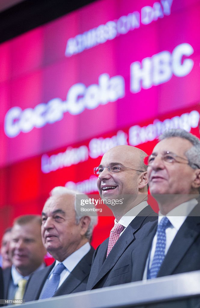 George David, chairman of Coca-Cola HBC (Hellenic Bottling Company) AG, left, and Dimitris Lois, chief executive officer of Coca-Cola HBC (Hellenic Bottling Company) AG, center, react during the launch of the company's listing at the London Stock Exchange in London, U.K., on Monday, April 29, 2013. Coca-Cola HBC is shifting its primary listing to London from the Greek stock exchange in an effort to reduce exposure to Europe's sovereign-debt crisis and improve access to international investors. Photographer: Jason Alden/Bloomberg via Getty Images
