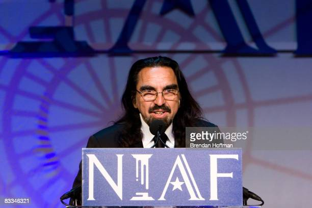 George DiCaprio father of actor Leonardo DiCaprio accepts a Special Achievement Award in Entertainment on his son's behalf at the National Italian...