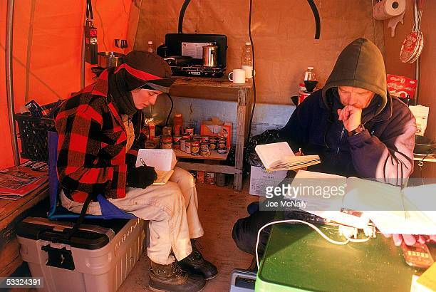 George Divoky and his assistant Tamara Enz pour over notes August 2001 on Cooper Island Alaska Ornithologist George Divoky has journeyed to Cooper...