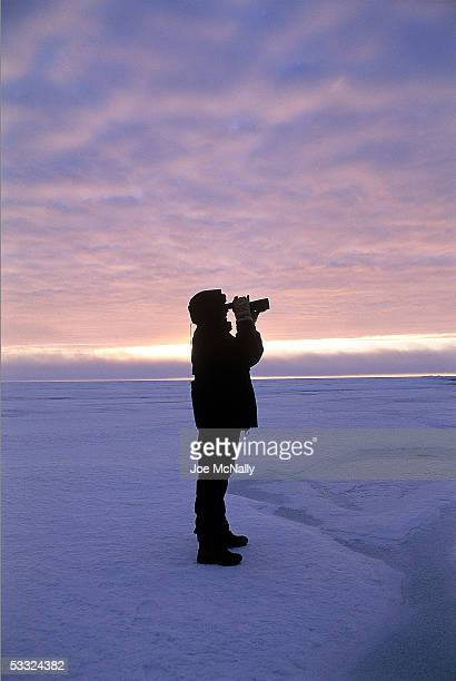 George Divoky scouts for Polar Bear August 2001 on Cooper Island Alaska Ornithologist George Divoky has journeyed to Cooper Island off the coast of...