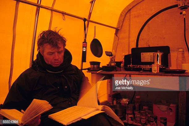 George Divoky studies his notes August 2001 on Cooper Island Alaska Ornithologist George Divoky has journeyed to Cooper Island off the coast of...