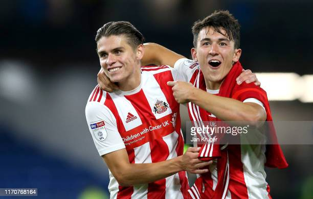George Dobson of Sunderland AFC and Luke O'Nien of Sunderland AFC celebrate following their sides victory in the Carabao Cup Second Round match...
