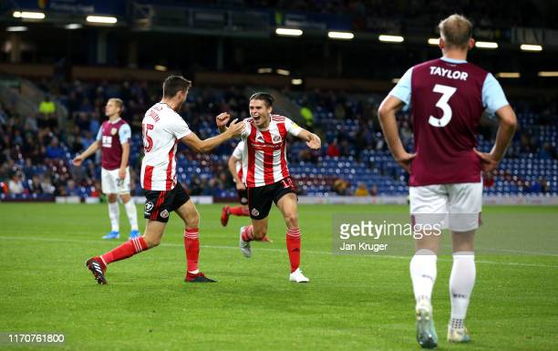 George Dobson of Sunderland AFC celebrates with team mate Jack Baldwin after scoring his team's third goal during the Carabao Cup Second Round match...