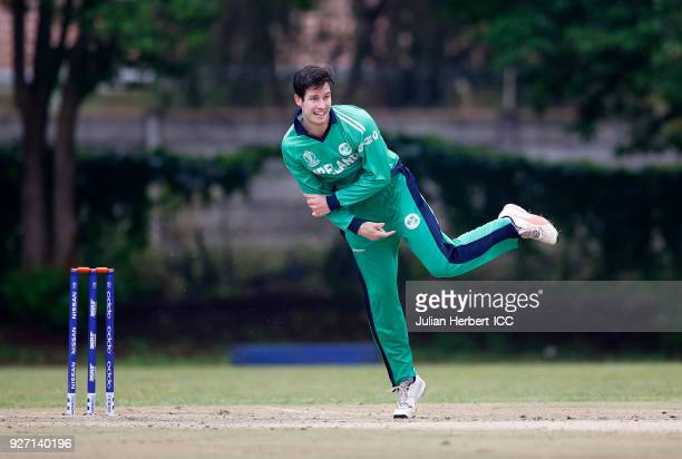 George Dockrell of Ireland bowls during the ICC Cricket World Cup Qualifier between Ireland and The Netherlands at The Old Hararians Ground on March...