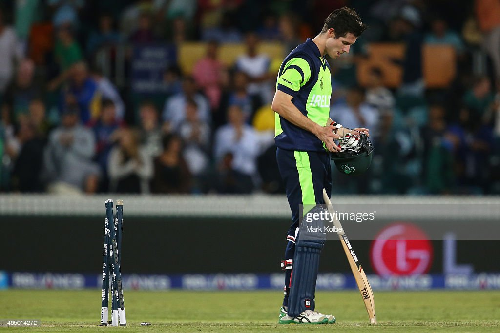 George Dockrell of Ireland looks dejected after being bowled by Morne Morkel of South Africa during the 2015 ICC Cricket World Cup match between South Africa and Ireland at Manuka Oval on March 3, 2015 in Canberra, Australia.