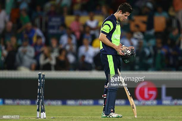 George Dockrell of Ireland looks dejected after being bowled by Morne Morkel of South Africa during the 2015 ICC Cricket World Cup match between...