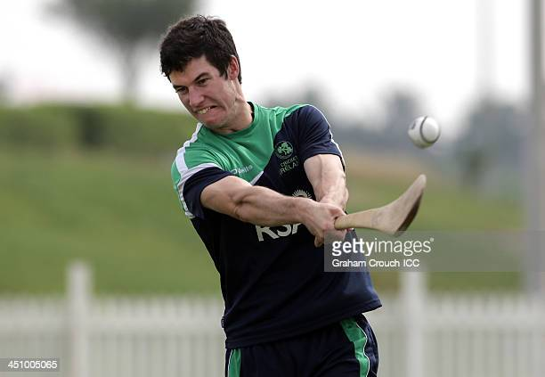 George Dockrell of Ireland plays the Irish game hurling waiting for the game to start after torrential rain delayed the start of play in the Ireland...