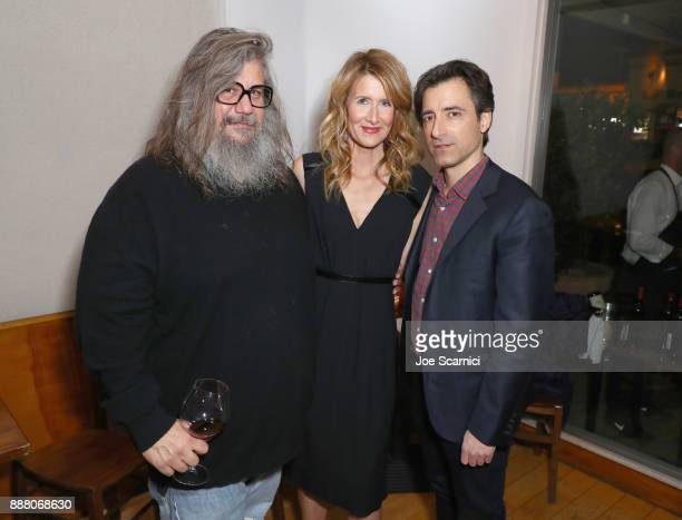 George Drakoulias Laura Dern and Noah Baumbach attend The Meyerowitz Stories reception at Angelini Osteria on December 7 2017 in Los Angeles...
