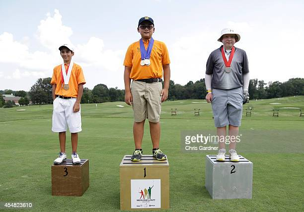 George Duangmanee of Fairfax VA center is joined on the podium by second place winner William Mirams right of Stroudsburg PA and and third place...