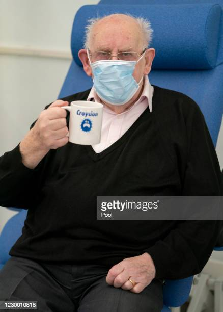 George Dyer has a cup of tea after becoming the first patient to receive a Pfizer-BioNTech COVID-19 vaccine in London at Croydon University Hospital,...