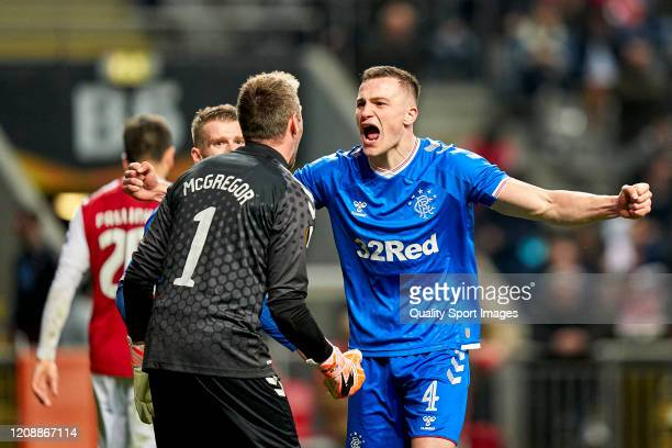 George Edmundson and Allan McGregor of Rangers FC celebrate the victory at the end of the UEFA Europa League round of 32 second leg match between...