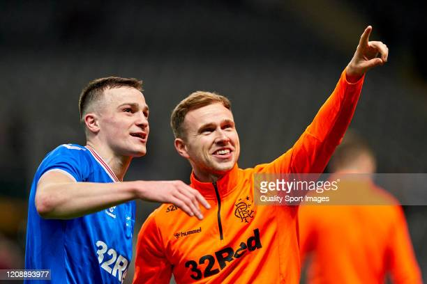 George Edmundson and Greg Stewart of Rangers FC celebrate the victory at the end of the UEFA Europa League round of 32 second leg match between...