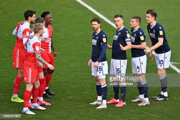 George Evans, Alex Pearce, Shaun Hutchinson and Matt Smith of Millwall form a line infront of the Wycombe defence to attack a corner kick during the...