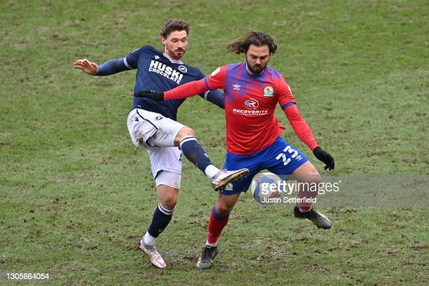 George Evans of Millwall FC and Bradley Dack of Blackburn Rovers battle for the ball during the Sky Bet Championship match between Millwall and...
