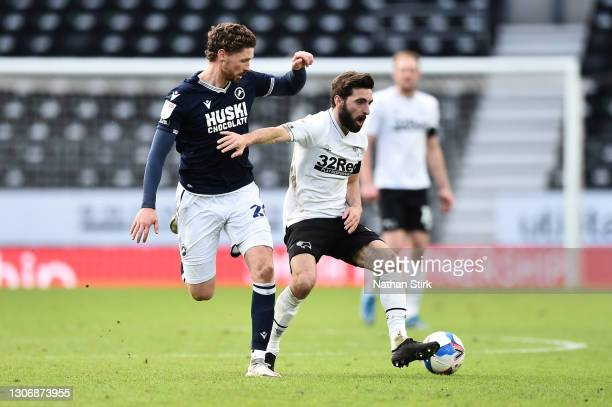 George Evans of Millwall FC and GraemeShinnie of Derby County battle for the ball during the Sky Bet Championship match between Derby County and...