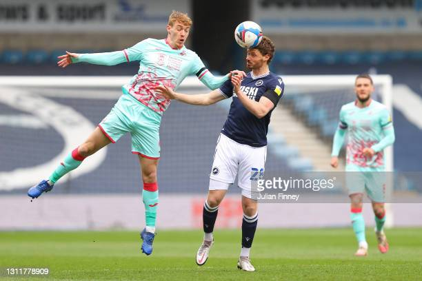 George Evans of Millwall FC and Jay Fulton of Swansea City battle for the ball during the Sky Bet Championship match between Millwall and Swansea...