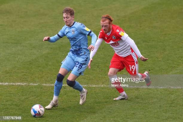 George Evans of Millwall in action with in action with Josh Eccles of Coventry City during the Sky Bet Championship match between Coventry City and...