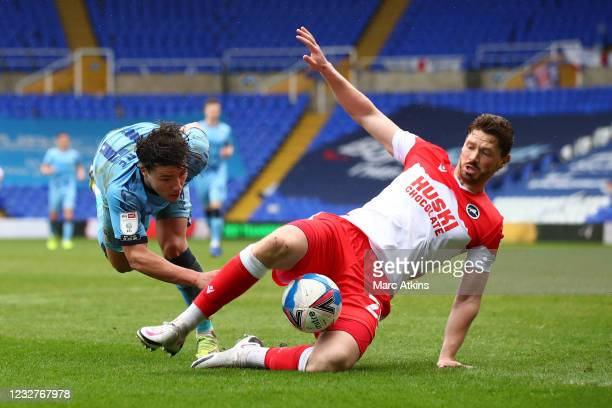 George Evans of Millwall tangles with Callum O'Hare of Coventry City during the Sky Bet Championship match between Coventry City and Millwall at St...