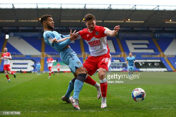 George Evans of Millwall tangles with Maxime Biamou of Coventry City during the Sky Bet Championship match between Coventry City and Millwall at St...