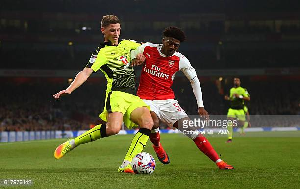 George Evans of Reading and Ainsley MaitlandNiles of Arsenal during the EFL Cup fourth round match between Arsenal and Reading at Emirates Stadium on...