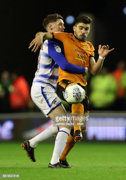 George Evans of Reading and Ruben Neves of Wolverhampton Wanderers during the Sky Bet Championship match between Wolverhampton Wanderers and Reading...