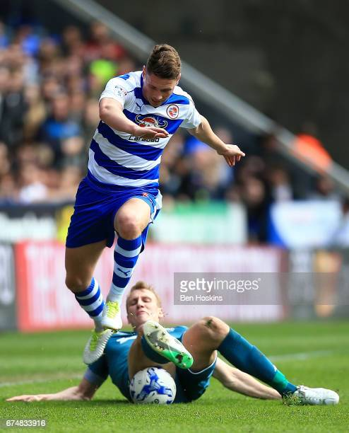George Evans of Reading is tackled by Dan Burn of Wigan during the Sky Bet Championship match between Reading and Wigan Athletic at Madejski Stadium...